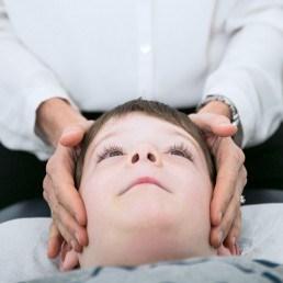 Family chiropractor chiropractic charlestown boy adjustment